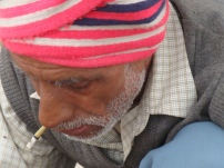 A cobbler smoking beedi